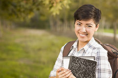 Portrait of a Pretty Mixed Race Female Student Holding Books Royalty Free Stock Image