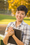 Portrait of a Pretty Mixed Race Female Student Holding Books Stock Photography