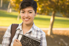 Portrait of a Pretty Mixed Race Female Student Holding Books Royalty Free Stock Photography