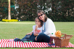 Pretty Mother And Girl Having Picnic In Park Stock Photo