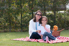 Pretty Mother And Girl Having Picnic In Park Royalty Free Stock Photo
