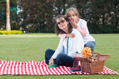 Pretty Mother And Girl Having Picnic In Park Royalty Free Stock Images