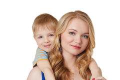 Portrait of pretty mother and son posing at camera Stock Photos