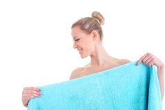 Portrait of the pretty naked woman covering her body with blue t. Owel,  on white background Royalty Free Stock Photography