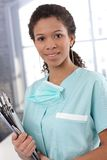 Portrait of pretty nurse with files Stock Photography
