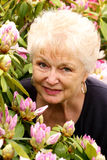 Portrait of a Pretty Older Lady in Her Flowers Stock Image