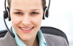 Portrait of a pretty operator with earpiece Royalty Free Stock Images