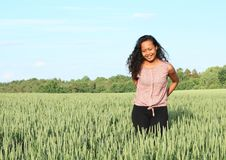 Portrait of pretty girl in field stock photography