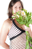 Portrait of pretty pregnant woman with flowers Royalty Free Stock Images