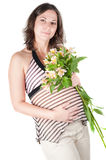 Portrait of pretty pregnant woman with flowers Stock Photo