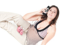 Portrait of pretty pregnant woman with headphones Stock Photography