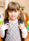 Portrait of pretty preschool girl with backpack Stock Image