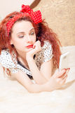 Portrait of pretty readhead lady  looking at Royalty Free Stock Photography