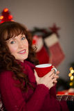 Portrait of pretty redhead enjoying hot drink Stock Images