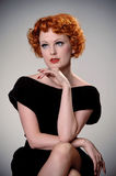 Retro portrait of vintage beauty. Portrait of pretty redhead in vintage forties dress Royalty Free Stock Images