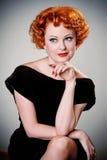 Retro portrait of vintage beauty. Portrait of pretty redhead in vintage forties dress Stock Photo