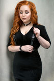 Portrait of pretty redhead woman in fashion clothes Stock Photography