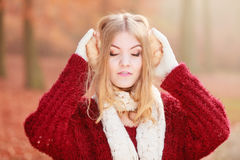 Portrait of pretty relaxed woman in earmuffs. Royalty Free Stock Images