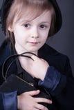 Portrait pretty retro dressed child girl.  studio photo, black background Stock Photos