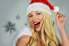 Portrait of pretty Santa girl laughing. Royalty Free Stock Image