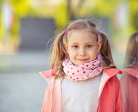 Portrait of pretty school girl in sunny park Royalty Free Stock Photography