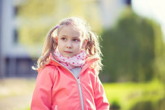 Portrait of pretty school girl in sunny park Stock Photo