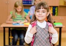 Portrait of pretty schoolgirl with backpack