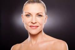 Senior woman beauty. Portrait of pretty senior woman beauty on black background Stock Photography