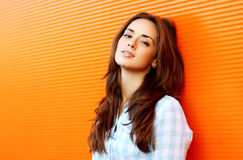 Portrait pretty sensual woman outdoors against colorful wall stock photos