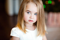 Portrait of a pretty serious girls baby blonde with straight hair,looking to the side , close up royalty free stock photo