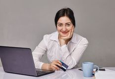 Portrait of pretty  young woman working in office Royalty Free Stock Photos