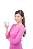 Portrait of pretty smiley asian young woman with glass of milk Royalty Free Stock Photo