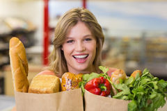 Portrait of pretty smiling blonde woman buying food products Royalty Free Stock Photography