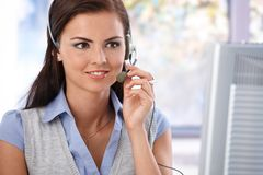 Portrait of pretty smiling dispatcher in work Stock Photo