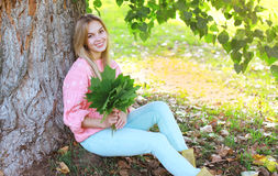 Portrait pretty smiling girl resting outdoors Stock Images