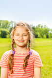 Portrait of pretty smiling girl with two braids Stock Photography