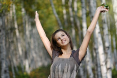 Portrait of a pretty smiling teen girl in autumn p Royalty Free Stock Photography