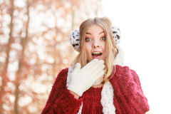 Portrait of pretty smiling woman in earmuffs. Stock Photos