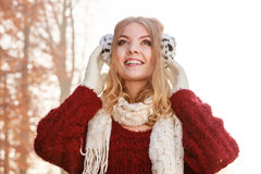 Portrait of pretty smiling woman in earmuffs. Stock Image