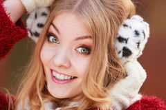 Portrait of pretty smiling woman in fur earmuffs. Royalty Free Stock Photo