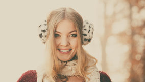 Portrait of pretty smiling woman in fur earmuffs. Stock Photography
