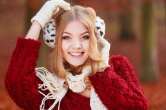 Portrait of pretty smiling woman in fur earmuffs. Royalty Free Stock Images