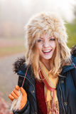 Portrait of pretty smiling woman in fur winter hat Royalty Free Stock Image