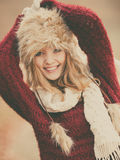 Portrait of pretty smiling woman in fur winter hat Stock Photography