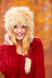 Portrait of pretty smiling woman in fur winter hat Stock Images