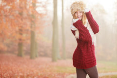 Portrait of pretty smiling woman in fur winter hat Stock Photo