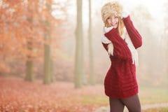 Portrait of pretty smiling woman in fur winter hat Stock Photo
