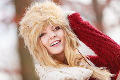 Portrait of pretty smiling woman in fur winter hat Royalty Free Stock Photography