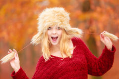 Portrait of pretty smiling woman in fur winter hat Stock Image