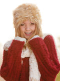 Portrait of pretty smiling woman in fur winter hat Stock Photos
